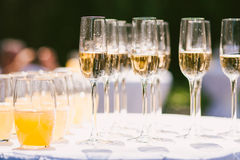 Glasses with different alcohol and nonalcohol drinks:  champagne and juice. Horizontal photo Royalty Free Stock Photos