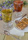 Glasses with different herbal teas and cookies. With nuts on a table Stock Image