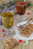 Glasses with different herbal teas and cookies. With nuts on a table Royalty Free Stock Photos