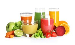 Glasses with different juices and fresh fruits and vegetables on white. Background stock images