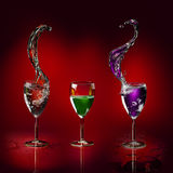 Glasses different kind liquid and splash Royalty Free Stock Photo