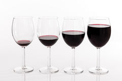 Glasses with different quantities of red wine Stock Photography