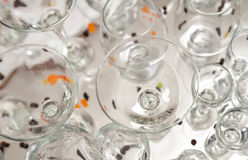 Glasses of different sizes are on the white tablecloth. Royalty Free Stock Images