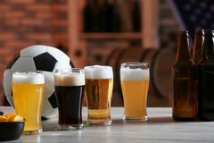 Glasses with different sorts of beer on table. In football bar Stock Photos