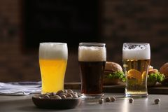 Glasses with different sorts of beer on table. In sport bar Royalty Free Stock Photo