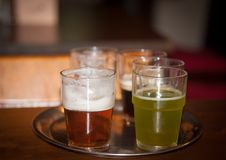 Beer of different colors in glasses. Royalty Free Stock Photos