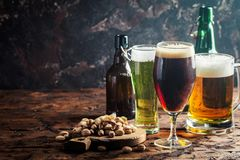 Different sorts of craft beer. Glasses with different sorts of craft beer on wooden table stock images