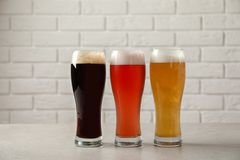 Glasses with different types of cold tasty beer. On table stock photos
