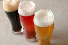 Glasses with different types of cold tasty beer. On table, closeup royalty free stock images