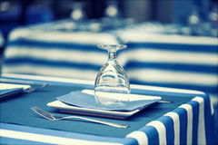 Glasses on a dining table - sailor styled terrace Royalty Free Stock Photography