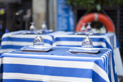 Glasses on a dining table - sailor styled terrace Stock Image