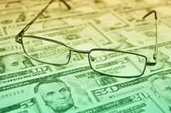 Glasses on dollar money, financial and business concept stock images