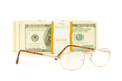 Glasses and dollar stack isolated Royalty Free Stock Photos