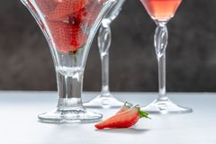 Glasses with drink and strawberries royalty free stock images