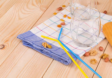 Glasses and drinking straws on tablecloth. Royalty Free Stock Images