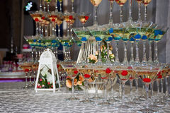 Glasses with drinks. In the form of a pyramid on the table Royalty Free Stock Photos