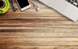 Glasses,earphone and smart phone on brown wooden Royalty Free Stock Image