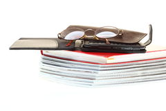 Glasses eBook reader pile of books, isolated Stock Image