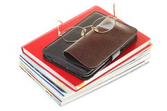 Glasses eBook reader pile of books, isolated Stock Images