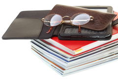 Glasses eBook reader pile of books, isolated Royalty Free Stock Images