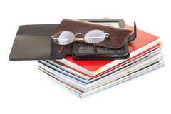 Glasses eBook reader pile of books, isolated on white Royalty Free Stock Photo