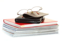 Glasses eBook reader pile of books, isolated on white Royalty Free Stock Images