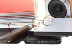 Glasses eBook reader pile of books,  on white Royalty Free Stock Images
