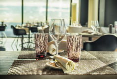 Glasses on empty restaurant table Stock Images
