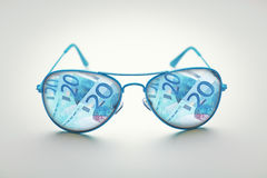 Glasses euro bank notes Stock Image