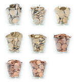 Glasses with Euro-Coins. Glasses filled up with Euro-Coins from 1 Cent up to 2 Euro on white background stock photography