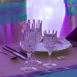 Glasses on event table Stock Photos