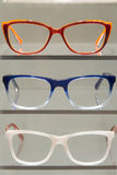Glasses in an Exhibitor. Colored glasses frames placed on a display for sale Stock Images