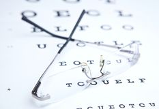 Glasses  & eye chart Stock Photos