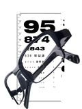 Glasses on eye chart Royalty Free Stock Photography