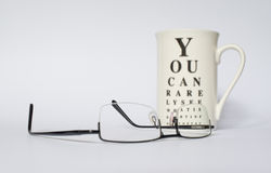 Glasses with eye chart mug Stock Images