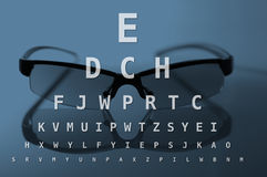 Glasses and eye test chart. Blue version Stock Photos