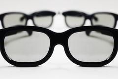 Glasses. 3 eye glasses on a white background with focus on the one in the front stock images