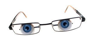 Glasses eyes spying. Pair of glasses with eyes looking at you, pry or spy. academic analyze or understand stock photography