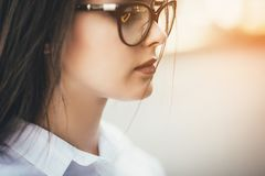 Glasses eyewear woman portrait looking away. Close up portrait of female business beautiful student woman model face stock photos