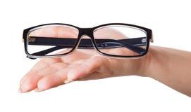 Glasses in female hands Stock Photo