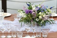 Glasses on the festive table setting. Wedding table decor concept. Table setting in classic style, setout. fine art. Royalty Free Stock Photo