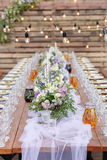 Glasses on the festive table setting. Wedding table decor concept. Table setting in classic style, setout. fine art. Stock Photography
