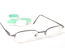 Glasses with few box of lenses. Glasses with lenses in second plan Royalty Free Stock Photography
