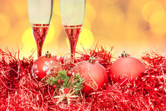 Glasses figure red Xmass bauble on blur background Stock Images