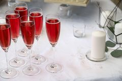 Glasses filled with champagne or sparkling wine on a white festive tablecloth background. Festive buffet, corporate event, royalty free stock images