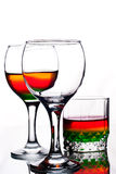 Glasses filled with rainbow coloured alcohol Stock Photography