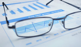 Glasses on financial chart and graph, success concept Royalty Free Stock Image