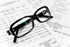 Glasses and financial documents Stock Image
