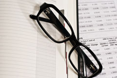 Glasses and financial documents Stock Images