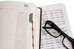Glasses and financial documents Stock Photos